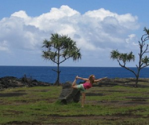 Photo of Rena doing yoga in Hawaii