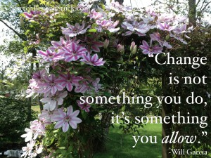 photo of flowers over arbor with quote
